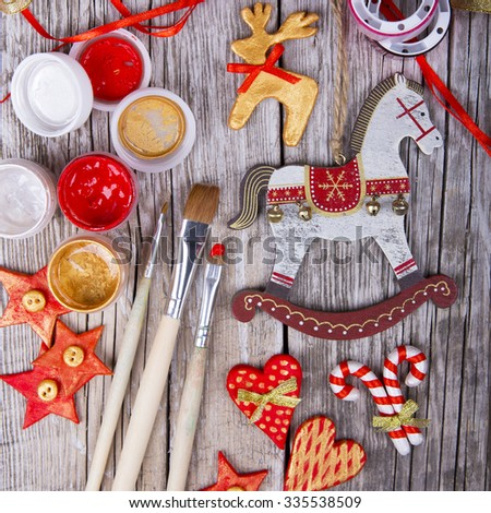 christmas decoration handmade toys over wooden background