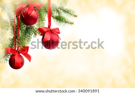 Christmas decoration (hanging balls) with space for text on abstract background - stock photo