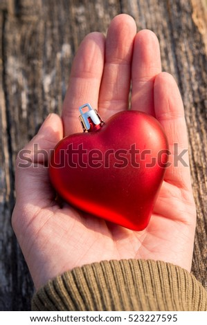 Christmas decoration heart in hand