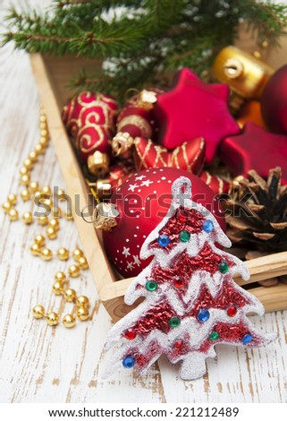 Christmas Decoration in box on a wooden background