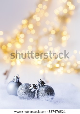 christmas decoration in front of blurred christmas light - stock photo