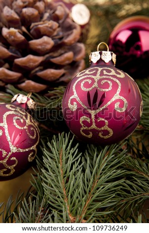 christmas decoration in gold and red on green background with tree space for text - stock photo