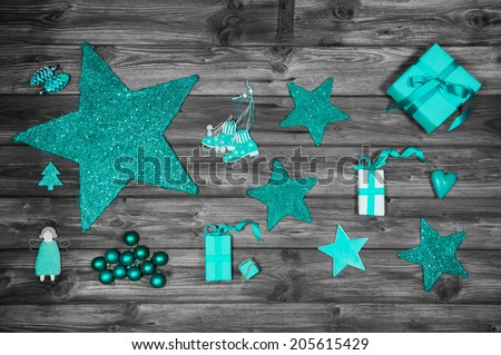 Christmas decoration in green or turquoise colors on wooden old shabby background with presents. - stock photo