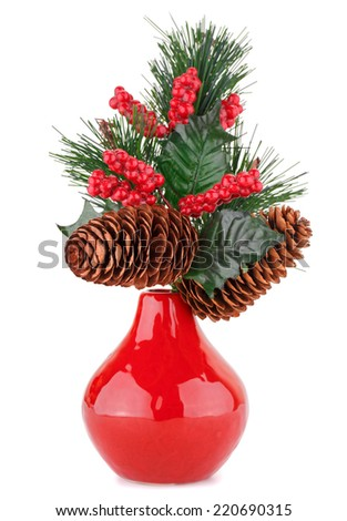Christmas decoration in red vase isolated on white background. - stock photo