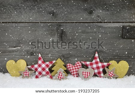 Christmas decoration in red white checked with gold on wooden background. - stock photo