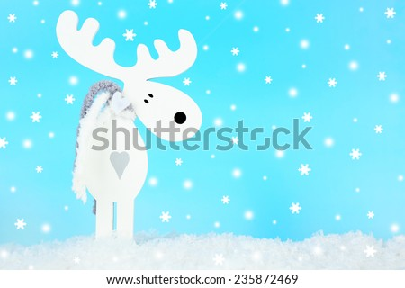 Christmas decoration in shape deer on light blue background - stock photo