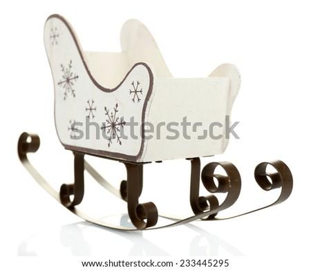 Christmas decoration in shape sled isolated on white - stock photo