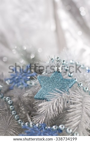 Christmas decoration in silver and blue tones. Star and snowflakes in the Christmas edition.  - stock photo
