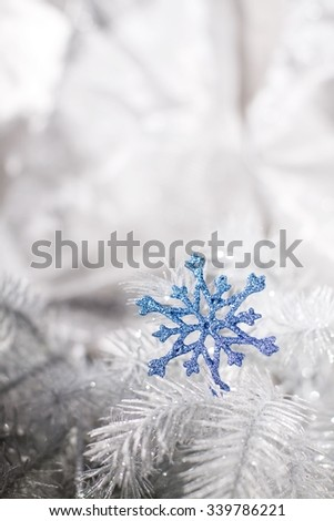Christmas decoration in silver tone with blue snowflakes.  - stock photo