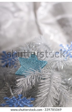 Christmas decoration in silver tone with blue star bauble and snowflakes.  - stock photo