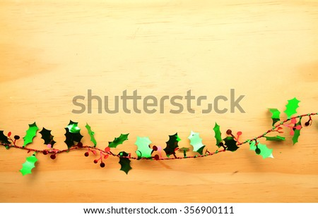 Christmas decoration iron Pentacle hanging decorations striped wire over wooden table background with copy space