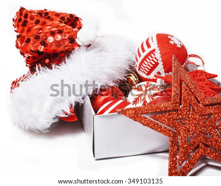 christmas decoration isolated , white background for post card greetings, toy design on tree macro, gifts under santas red hat close up - stock photo