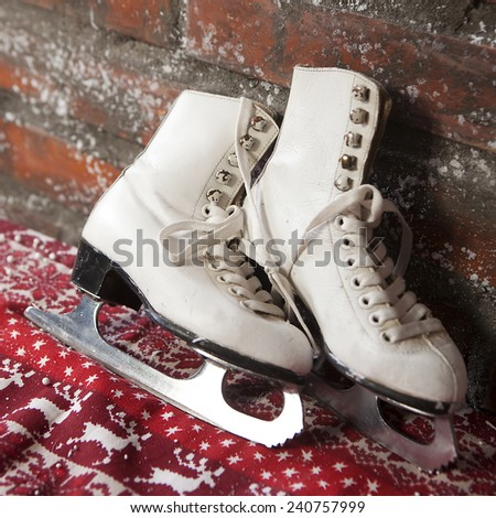 Christmas decoration made by designed vintage skates. Skates on artificial snow - stock photo