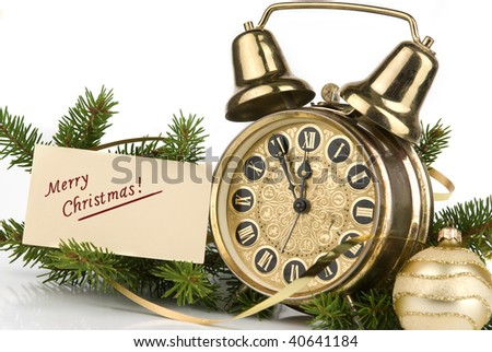Christmas decoration. Merry Christmas card and antique clock