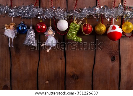 Christmas decoration of Christmas toys. New Year's toys on a wooden background. - stock photo