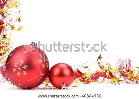 Christmas decoration of garland and red ball on white background.