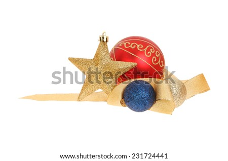 Christmas decoration of gold glitter star, ribbon and baubles isolated against white - stock photo