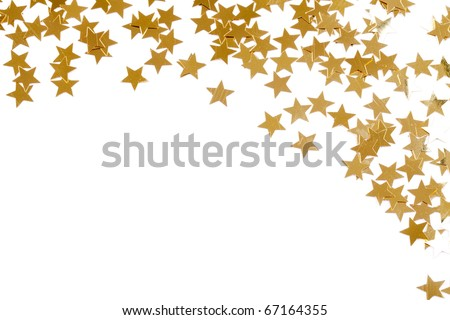 Christmas decoration of golden confetti stars against white background with nice bokeh - stock photo