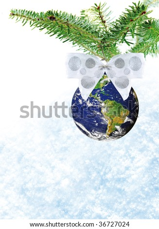 Christmas decoration of planet earth with white bow on christmas tree on snow background