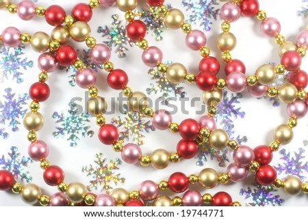Christmas decoration of shining beads and snowflakes