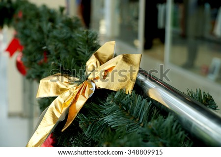 Christmas decoration of shopping center spheres, bows and branches of a fir-tree