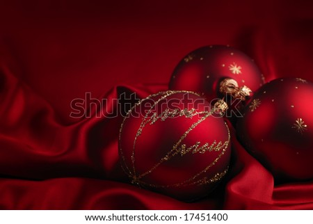 Christmas decoration on a red silky background - stock photo