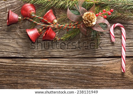 Christmas decoration on aged wooden background  - stock photo