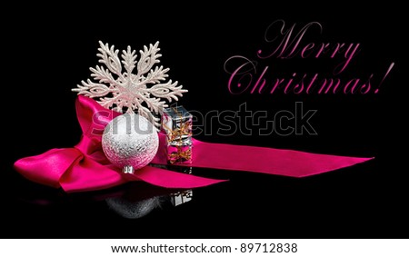 Christmas Decoration on black background with sample text - stock photo