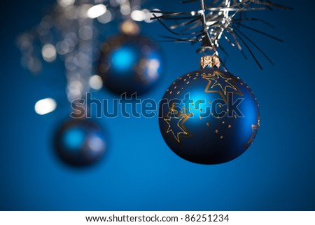 Christmas decoration on dark blue background, shallow deep of field - stock photo