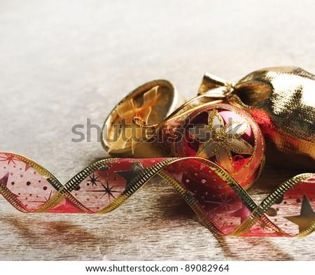 Christmas decoration on golden background - stock photo