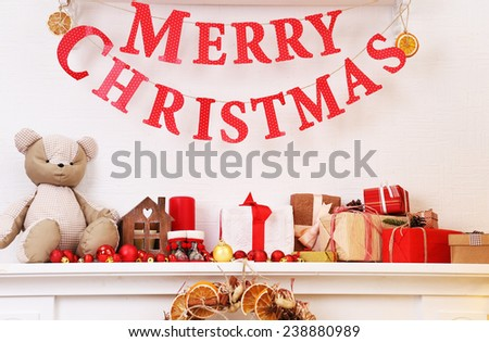 Christmas decoration on mantelpiece on white wall background - stock photo