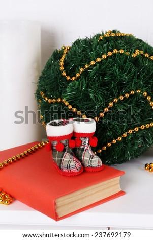 Christmas decoration on mantelshelf on white background - stock photo