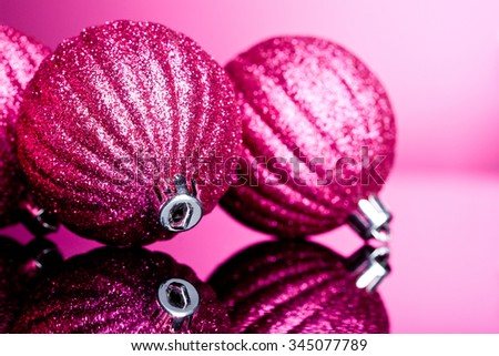 Christmas decoration on pink background - stock photo