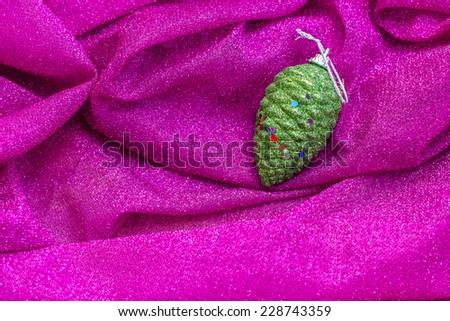 Christmas decoration on pink fabric background  - stock photo