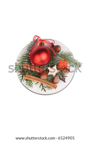 Christmas  decoration on plate, isolated over white background - stock photo
