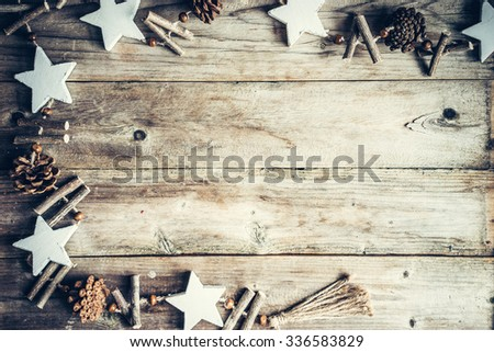 Christmas decoration on rustic wooden background - stock photo