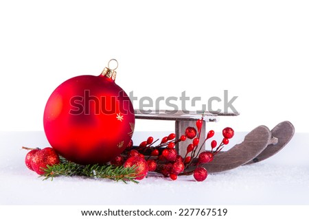Christmas decoration on snow, Red ball and sledge isolarted on white background - stock photo