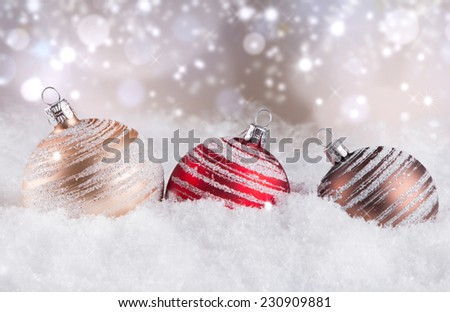 Christmas decoration on snow with abstract background  - stock photo