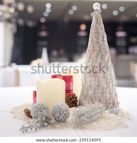 Christmas decoration on white table - stock photo