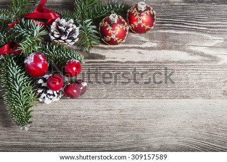 Christmas decoration on wooden plank - stock photo