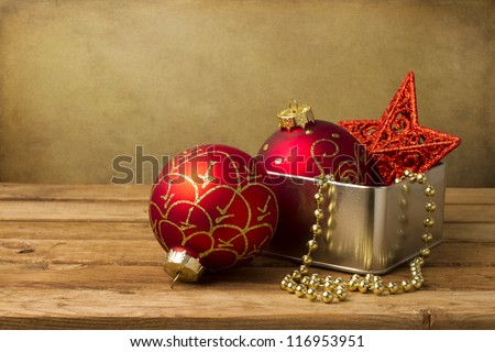 Christmas decoration on wooden table over grunge background - stock photo