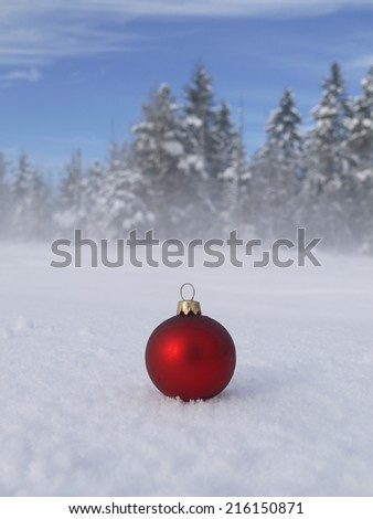 Christmas decoration outside in real snow during snowfall - stock photo