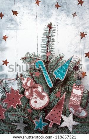 Christmas decoration over grunge background/vintage paper christmas decoration on christmas tree - stock photo