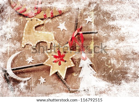 Christmas decoration over grunge  background/vintage paper christmas decoration with a sign and red ribbon