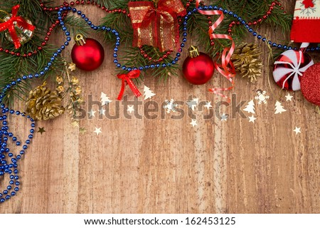 Christmas Decoration Over Wooden Background. Beige paper  card background with Christmas border