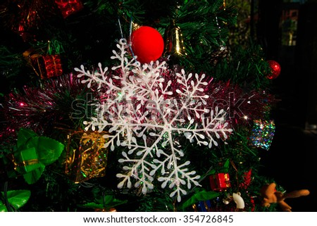 Christmas decoration, pine cones,gift,baubles,on christmas tree - stock photo
