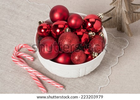 Christmas Decoration. Red Balls And Bells. Natural Linen Background. - stock photo