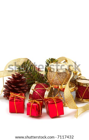 Christmas decoration, red, silver & gold drums, pine cones, ribbons, isolated on white background. Vertical, portrait orientation.