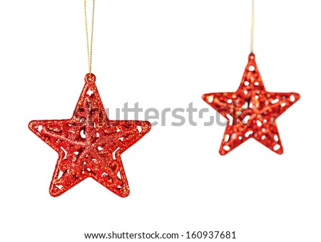 Christmas decoration. Red stars isolated on white background. Selective focus - stock photo