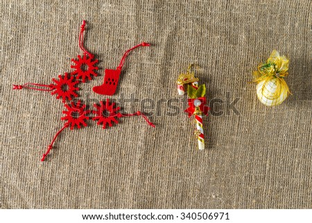 Christmas Decoration. Red toys. Natural Linen Background.
